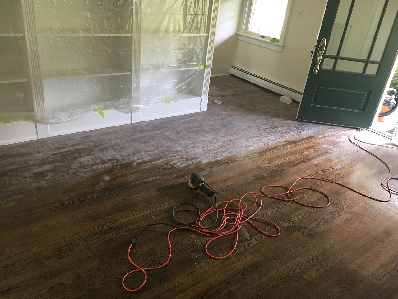 sanding the floor